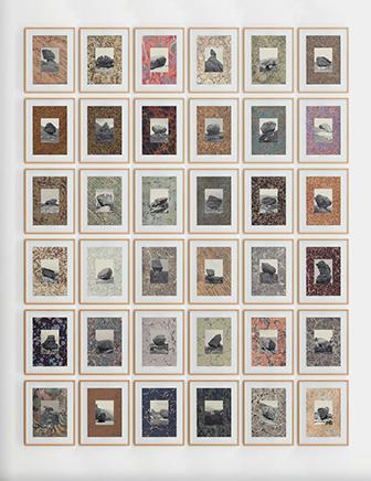Erratic MarblesVista de instalaciónSerie de 32 collages. Impresión sobre páginas encontradas e impresión Glicleé sobre papel Hahnemühle Museum Etching 350g46.3 x 37 x 4.1 cm c/u2014