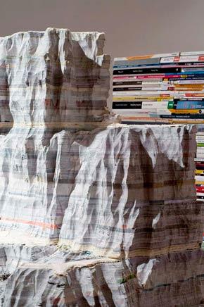 INTERSECCION DE PAISAJEDetalleCuatro mesas de madera, acero, libros escolares tallados300 X 180 x 300 cm2010